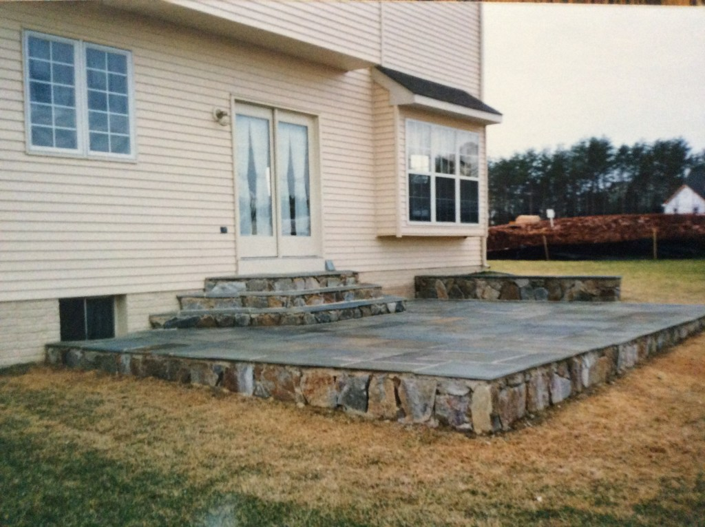 raised flagstone backyard patio by capital masonry