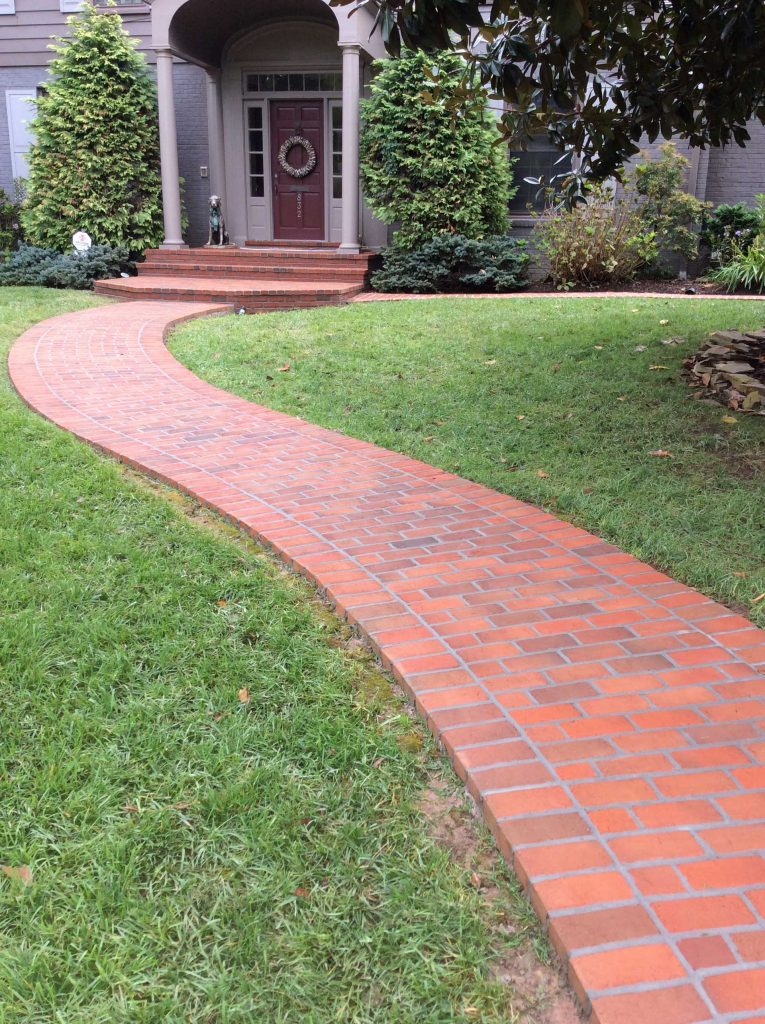 front yard brick path with curves