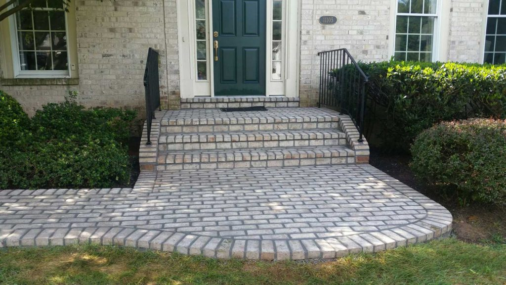gray brick front porch path and steps
